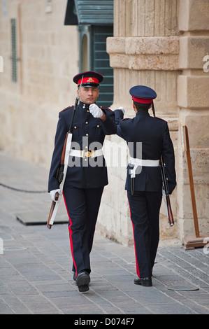 Sentries on guard duty outside the Grandmasters Palace, Valletta, Malta - Stock Photo