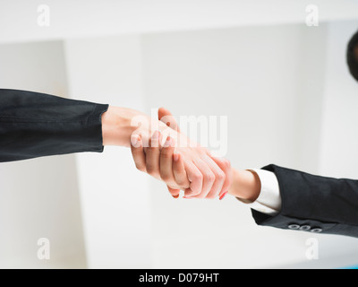 Handshaking in office low angle - Stock Photo