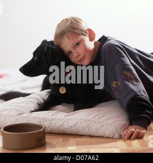 Preteen boy and pet dog - Stock Photo