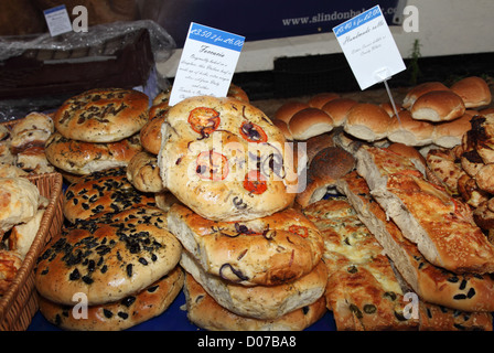 Specialty breads including Foccacia at  Chichester open air market England UK - Stock Photo
