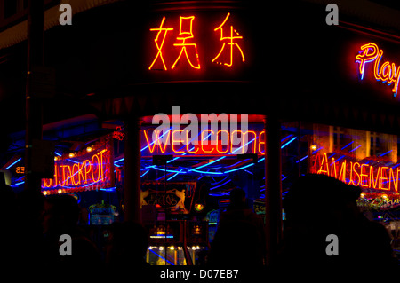 Neon signs outside an amusement arcade in Chinatown, London. - Stock Photo