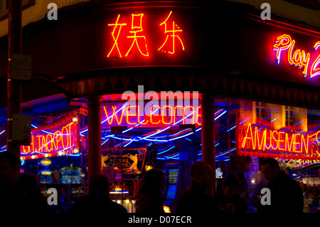 Neon signs outside an amusement arcade in Chinatown, London - Stock Photo
