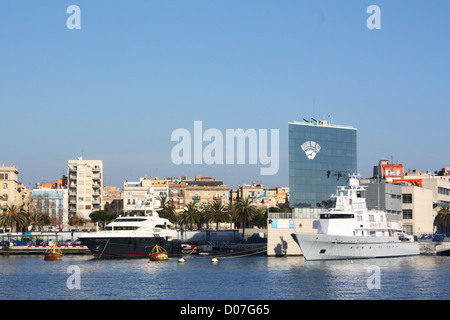 Boats and buildings in Barcelona city, Spain - Stock Photo
