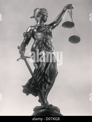 Lady Justice Sculpture of woman w/ithsword and scale - Stock Photo