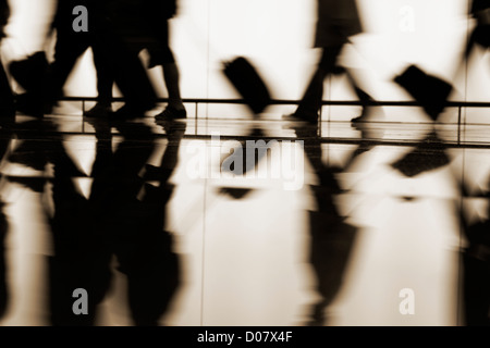 Passengers walking towards boarding gates at El Prat airport. Barcelona, Spain - Stock Photo