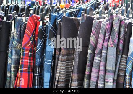 Scottish Kilts on Hanger in Store - Stock Photo