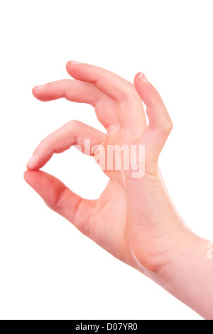 Kids hand is making OK sign over white background - Stock Photo