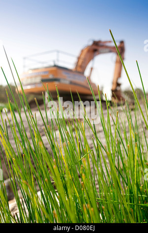 Earth mover on construction site - Stock Photo