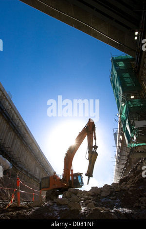 Excavator drilling on construction site - Stock Photo