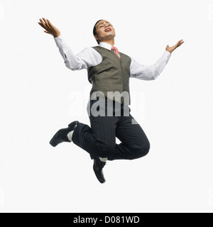 Mime jumping in mid-air - Stock Photo