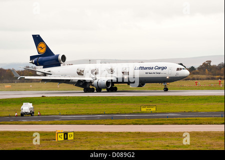 Lufthansa Cargo Airlines Mc Donnell Douglas MD-11F Freighter Airliner D-ALCC Landing at Manchester Airport England - Stock Photo