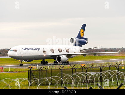 Lufthansa Cargo Airlines Mc Donnell Douglas MD-11F Freighter Airliner D-ALCC Taxiing at Manchester Airport England - Stock Photo