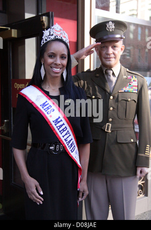 Mrs. Maryland America 2010 Raquel Riley Thomas poses with General Dwight Eisenhower's wax work at Madame Tussauds - Stock Photo