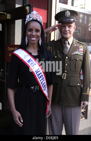 Mrs. Maryland America  Raquel Riley Thomas poses with General Dwight Eisenhower's wax work at Madame Tussauds Washington - Stock Photo