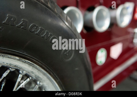 wire wheel of classic racing car - Stock Photo