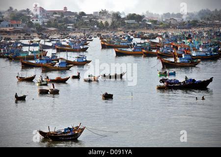 TRADITIONAL FISHING BOATS IN MUI NE VIETNAM ASIA - Stock Photo