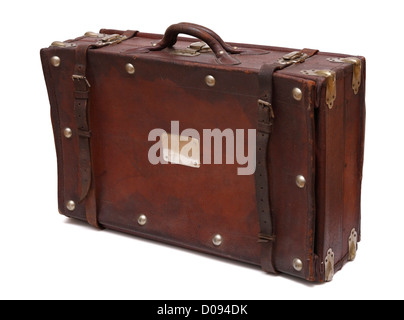 Old-fashioned suitcase made from brown leather with leather belts and metal rivets. - Stock Photo