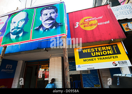 PICTURE STALIN LENIN ON COMMUNIST PARTY PROPAGANDA POSTER HANGING ON FACADE BANK PARAVUR KERALA SOUTHERN INDIA ASIA - Stock Photo
