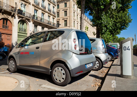 Autolib bluecar designed by Pininfarina at the electric car-sharing scheme charging station point Paris France EU - Stock Photo
