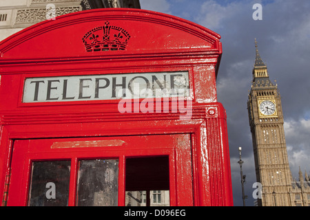 CLOSE-UP OF A LONDON TELEPHONE BOOTH WITH BIG BEN IN THE BACKGROUND LONDON ENGLAND GREAT BRITAIN UNITED KINGDOM - Stock Photo