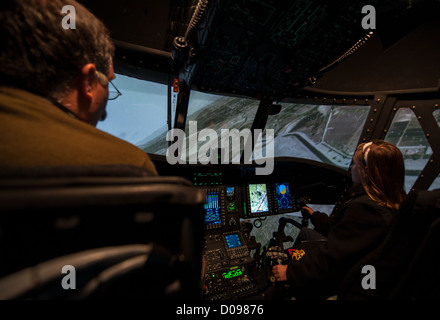 Rebecca Rascon, right, flies a CH-47F simulator with help from instructor Pat Turner, left, during a Nov. 19, 2012 - Stock Photo