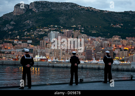 Sailors aboard the amphibious command ship USS Mount Whitney (LCC 20) man the rails as the ship arrives in Monaco - Stock Photo