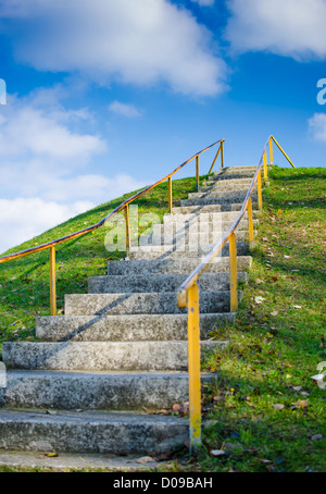 Steep Outdoor Stairs On Grassy Hill Into The Sky - Stock Photo