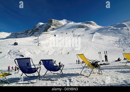Chairs on the ski piste in Hintertux gletcher, Zillertal, Austria - Stock Photo
