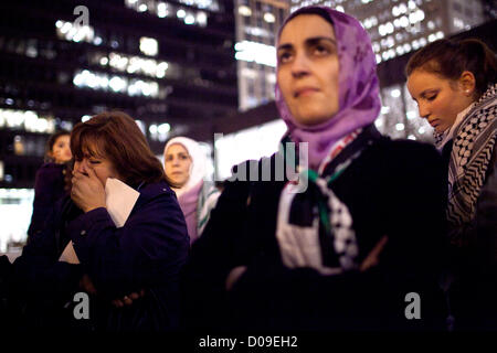 Nov. 19, 2012 - Chicago, Illinois, U.S. - Protester Magda Castaneda (left) weeps while a speaker read a list of - Stock Photo