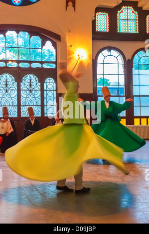 Whirling dervishes, Istanbul, Turkey - Stock Photo
