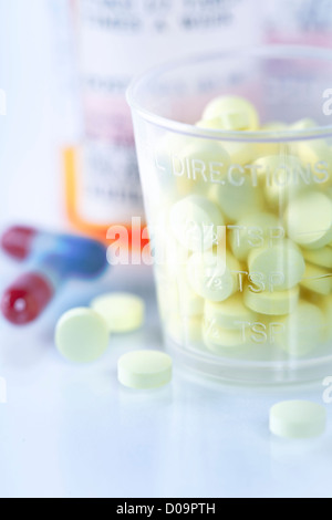 Medicine bottles and pills close up with copyspace - Stock Photo