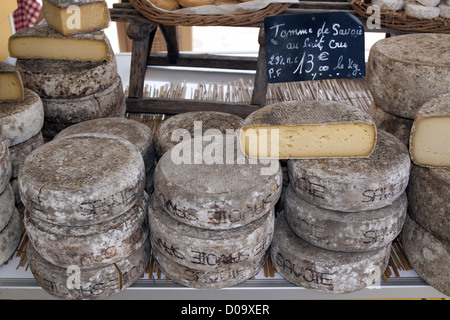 TOMMES DE SAVOIE CHEESES ON SALE ON A CHEESE-MAKER'S STALL IN THE MARKET OF ALLEVARD ISERE RHONE-ALPES FRANCE - Stock Photo