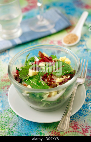 Salad with apple and dates. Recipe available. - Stock Photo