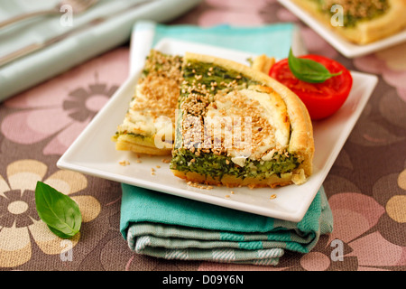 Puff pastry with spinaches and goat cheese. Recipe available. - Stock Photo