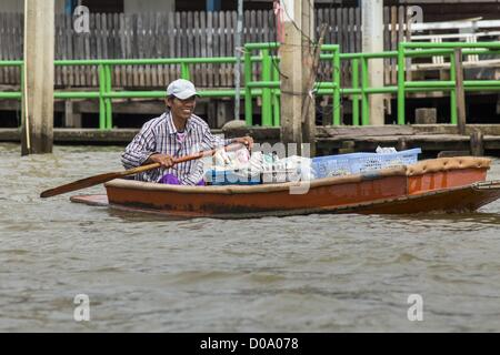 Man Paddles Canoe On Still Water Of Small Creek In