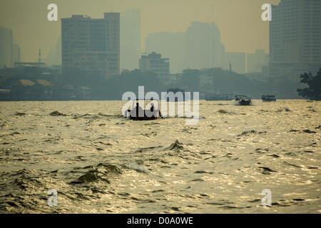 Nov. 21, 2012 - Bangkok, Thailand - Morning boat traffic on the Chao Phraya River in Bangkok. The Chao Phraya Express - Stock Photo