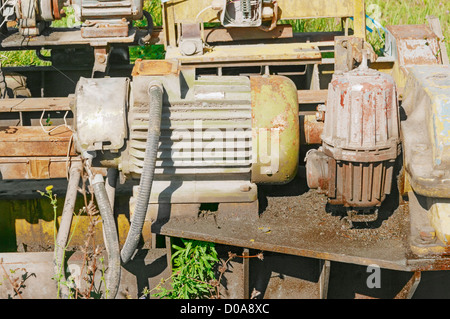 The old rusty machine with the electromotor. - Stock Photo