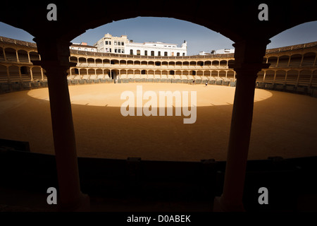 Sunlight creates perfect circle inside empty Spanish bull fighting arena spotlighting interior, shaded seats before - Stock Photo