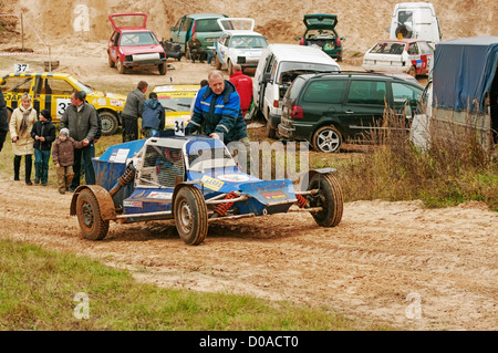 Blue buggy goes on parking. - Stock Photo