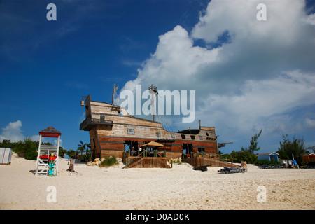Beach on Half Moon Kay - Bahamas Old pirate ship - Stock Photo
