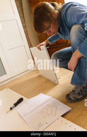 Woman assembling ikea flat pack furniture england uk stock photo royalty free image 29613173 - Diy tips assembling flat pack furniture ...
