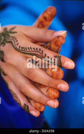 HANDS PAINTED WITH TEMPORARY TATTOOS REPRODUCING THE EMBROIDERY OF MARRAKECH TRADITIONAL MAKE-UP MARRAKECH MOROCCO - Stock Photo