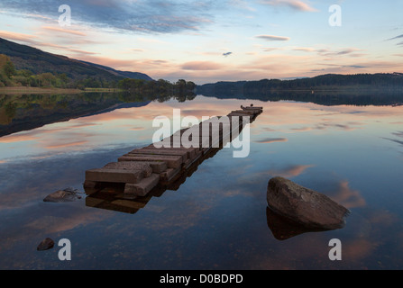 Loch Ard in the Loch Lomond and the Trossachs National Park, Stirling, Scotland at Sunset on a calm evening - Stock Photo
