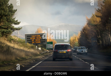 Electronic sign warning of deer on the A9 road near Aviemore in Scotland. - Stock Photo
