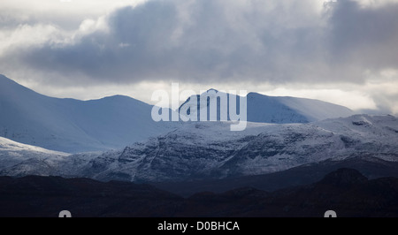 The lower slope of Sgurr Mhor and Tom na Gruagaich forming a snow capped Ben Alligin. - Stock Photo