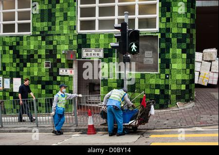 Hong Kong, 6 March 2012 Garbage collectors in Jubilee Street in Central. Photo Kees Metselaar - Stock Photo