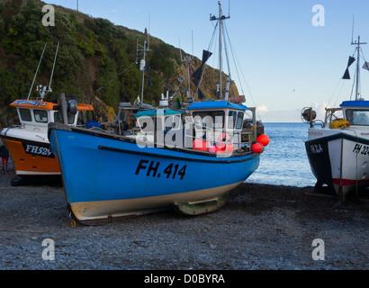 Fishing boats drawn up on the shingle at Cadgwith, Cornwall. - Stock Photo