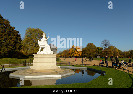 Statue of Queen Victoria outside Kensington Palace, Hyde Park, London,UK - Stock Photo