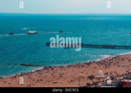 The Space Shuttle prototype Enterprise sails barge past Steeplechase Pier in Coney Island Brooklyn in this aerial - Stock Photo