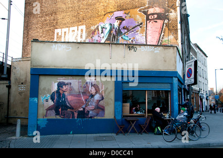 Hackney November 18th 2012. Corner of Andrews Road and Mare Street. Photo and mural on cafe wall. - Stock Photo